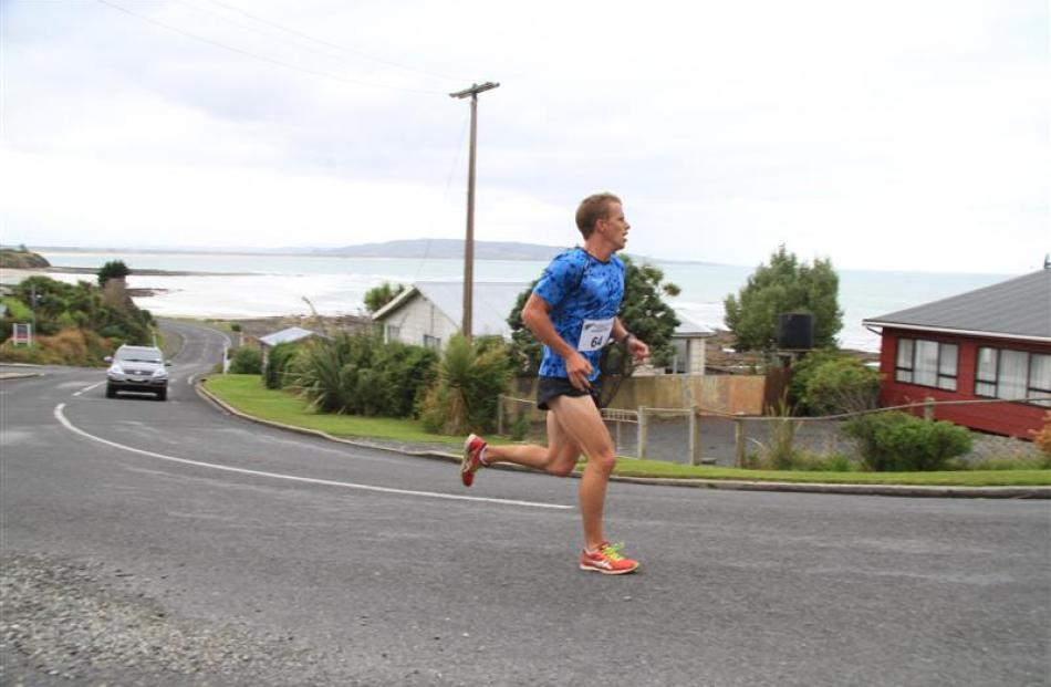 Mel Aitken leads all women in the  half marathon from Balclutha to Kaka Point. Photos by Hamish...