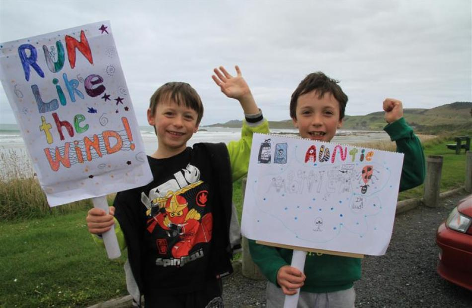 Riley (6), left, and Callum Wilson (8), of Gore, show their support for their aunt Monica Wilson,...