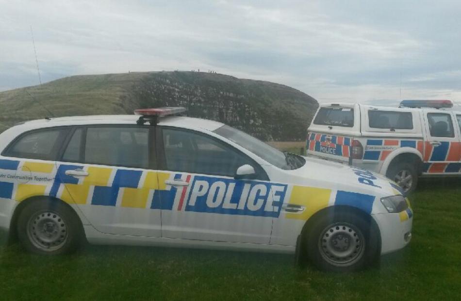Police cars at Curio Bay. Photo by Hamish MacLean.