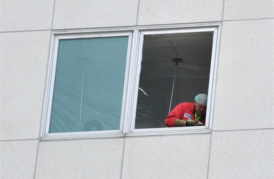 Work is carried out on a window of the clinical services building at Dunedin Hospital.