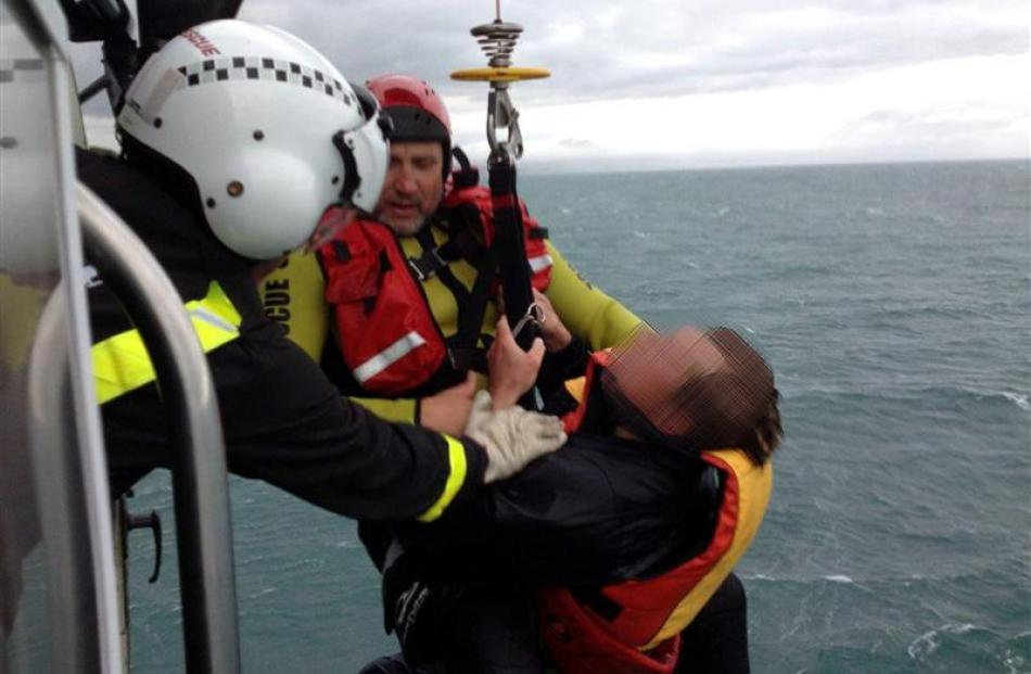 One of two hypothermic men rescued yesterday after clinging to a capsized kayak for up to four...