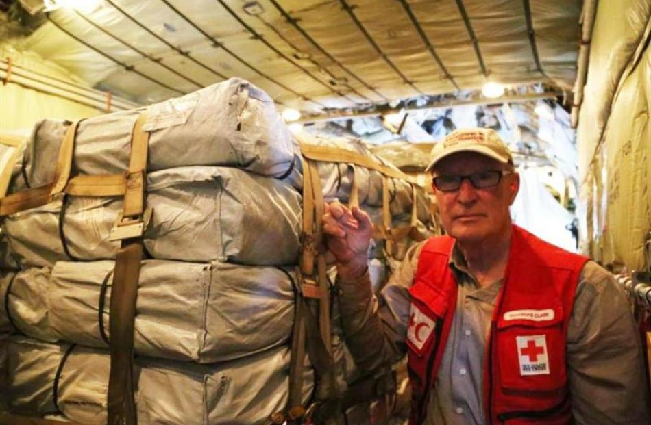 Douglas Clark in the C130 Hercules with aid supplies.