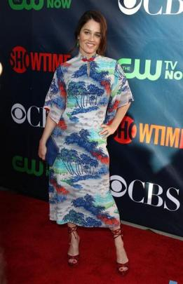 Dressed in a 1940s rayon gown from The Way We Wore, Robin Tunney, star of television series The...