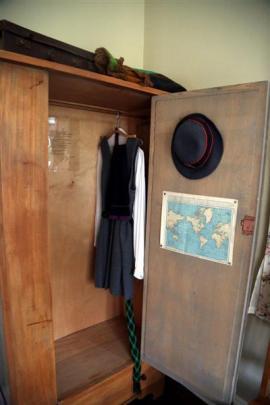 An old Waitaki Girls' High School uniform hangs in the wardrobe of Janet Frame's old bedroom.