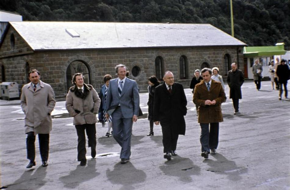 Otago Harbour Board chairman Cliff Skeggs (centre, in blue) with Prime Minister Robert Muldoon ...