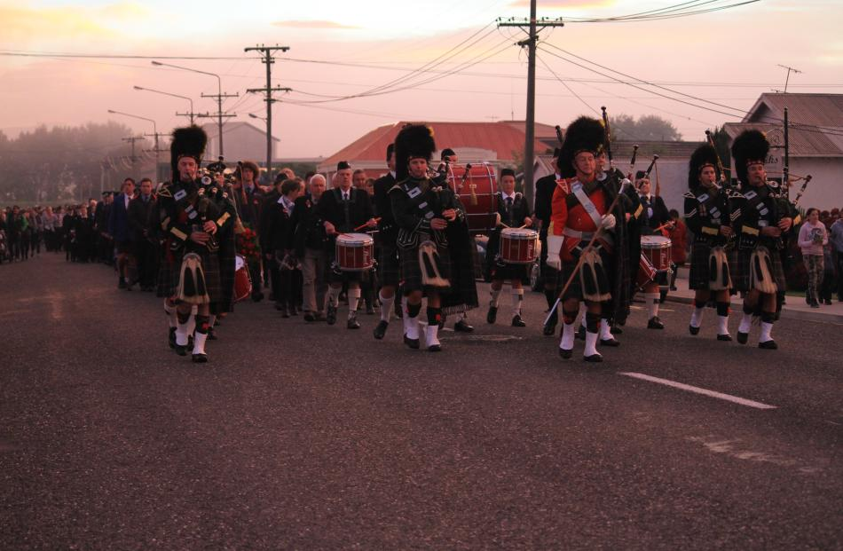 100 years on . . . The Balclutha Pipe Band leads a parade of about 500 down Renfrew St in...