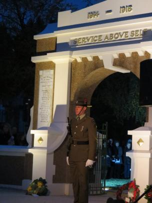 A soldier stands guard at the Queenstown Memorial Gates during the dawn service this morning. ...