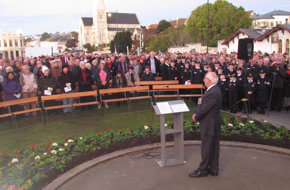 Returned Services Association representative John Longman addresses part of the estimated 3000...