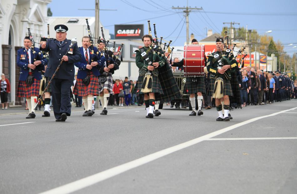 Stirring . . . The Bruce District Combined Pipe Band began the parade along Untion St in Milton...