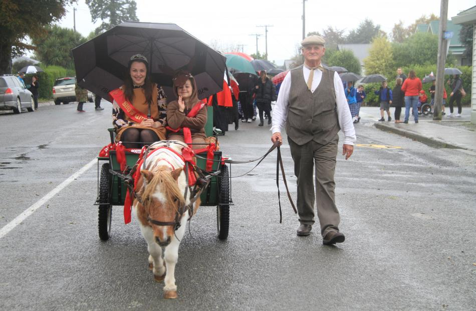 South Otago A&P Show 2014 show queen Georgia Scott, left, is joined by Ella McCarthy (7) for a...