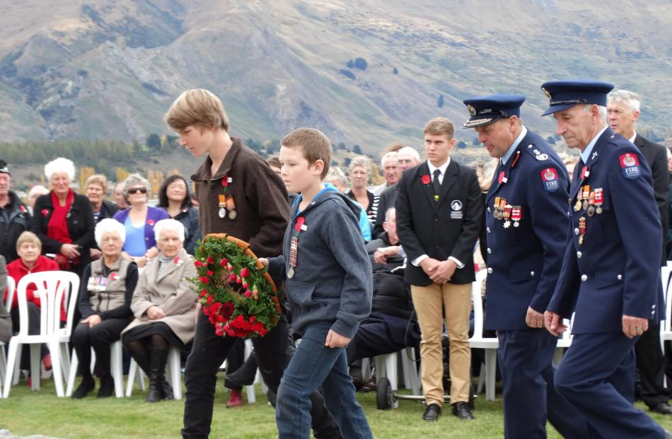 Nick (15) and Liam (10) Bates, wear the medals of their late father, Wanaka volunteer firefighter...