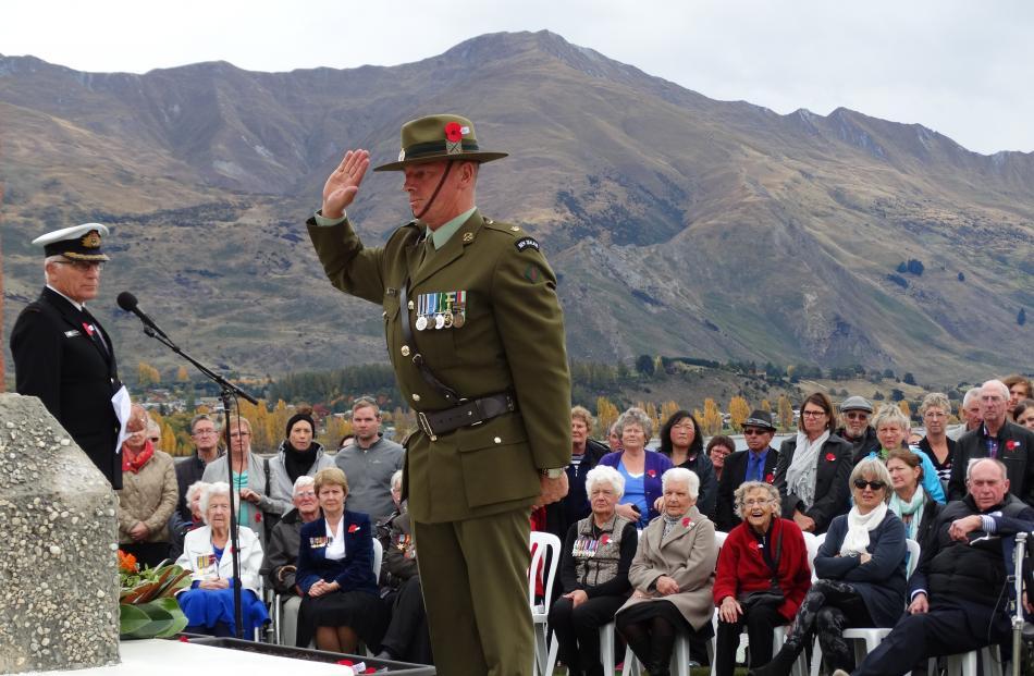 Wanaka man Major Ian Piercy, 2/4 Battalion Royal New Zealand Infantry Regiment, salutes at the...