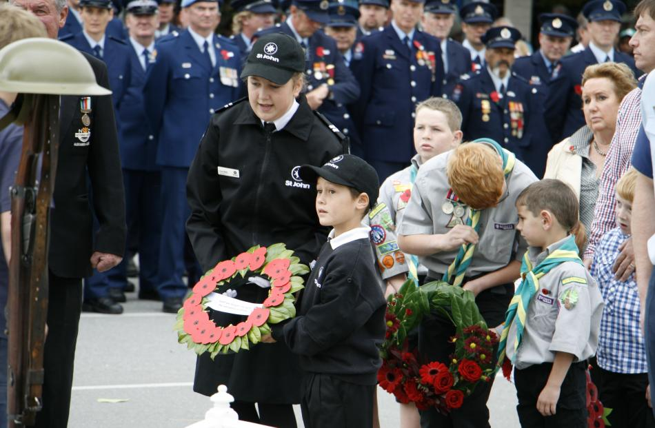 Preparing to lay wreaths are, from left, St Johns youth member Grace Wells (16) and St Johns...