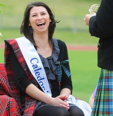Edie-Mae Wilkins is crowned Queen o' the Heather as strong winds buffet the Logan Park sports...