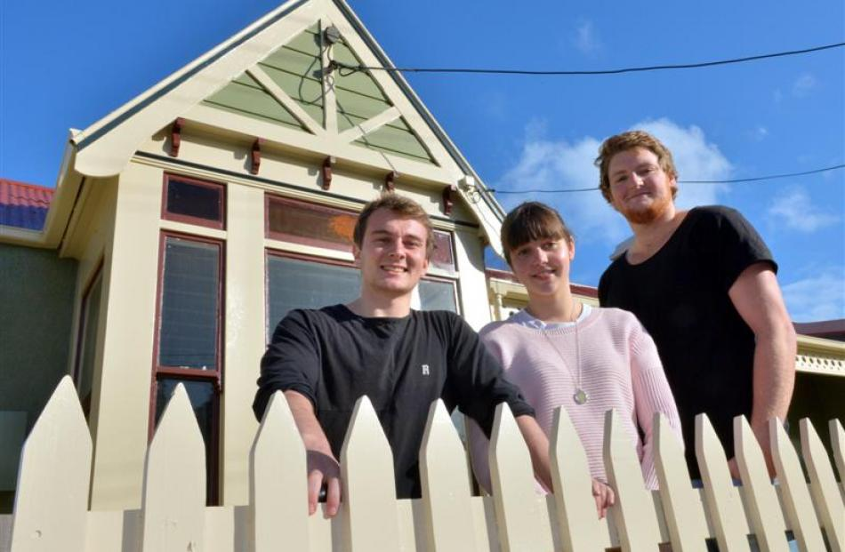 Will Hewitt (right), Laura Russell (21), Tony McKinnie (22) live in one of Jim Casey's many flats...