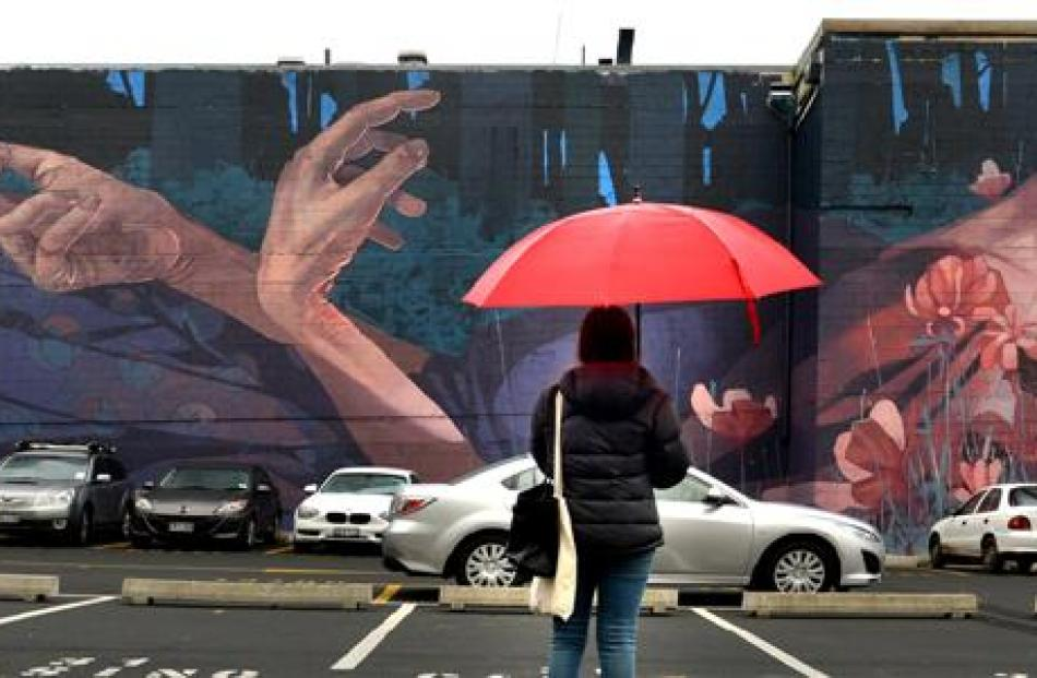 Shelley Mackay admires a Dunedin mural by Polish artist Bezt in the Scenic Circle Southern Cross...