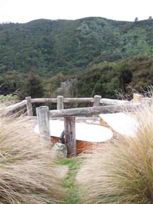 Outdoor baths at Cascade Creek Retreat boast a spectacular view.