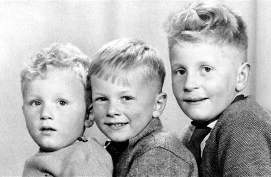 Lee Vandervis (aged about 8) flanked by his brothers. Supplied photo.