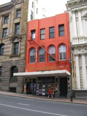 This photograph, taken in September 2009, shows the red-painted Standard Building immediately...