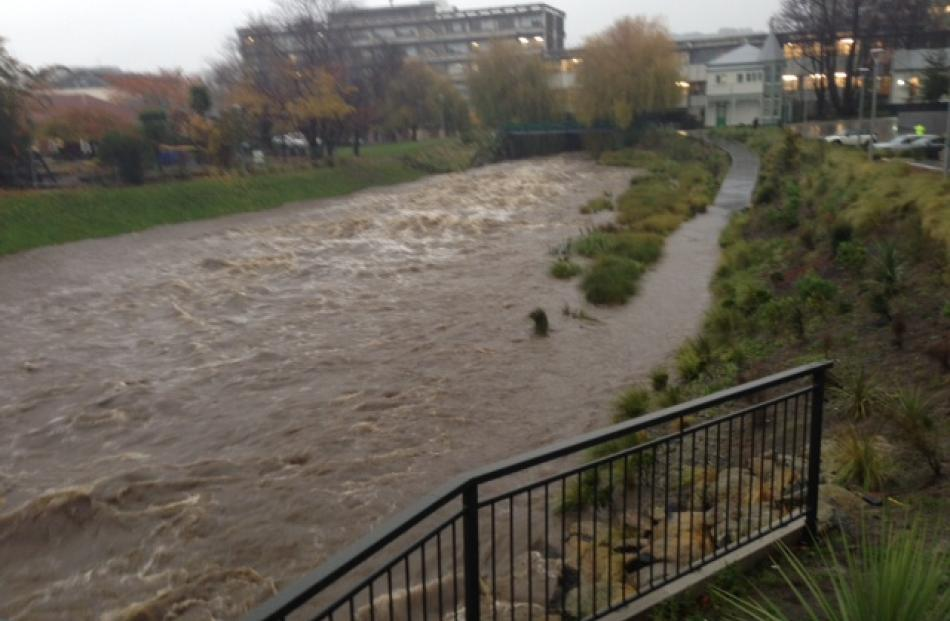 The swollen Leith near the University of Otago's Commerce Building.