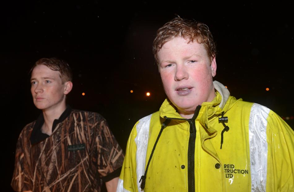 Adam Pearce (left) and Josh Hastie used a small fibreglass dinghy to evacuate about 10 elderly...