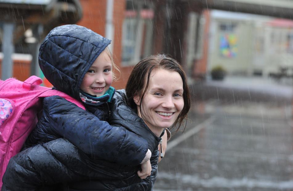 alia Morrison (5) and Annalies Scott were happy enough evacuating from East Taieri School. PHOTO:...