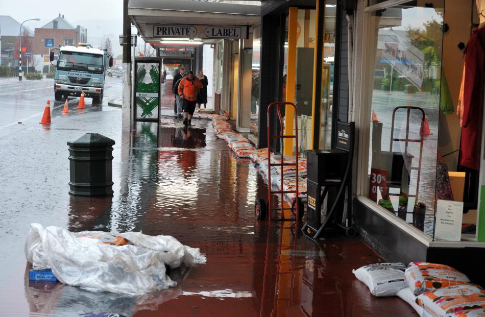 Flooding and sandbags in  Gordon Rd, Mosgiel,  yesterday.  PHOTO: GREGOR RICHARDSON