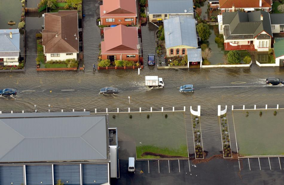 A flooded Bayview Road in South Dunedin as seen from the air this morning. Photo by Stephen Jaquiery