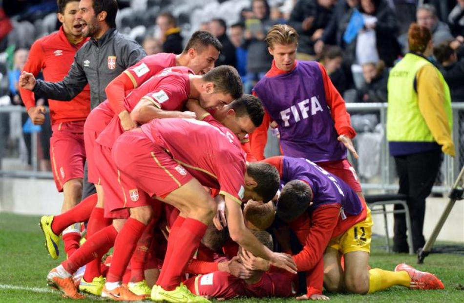 Serbians celebrate scoring.  Photo by Stephen Jaquiery.