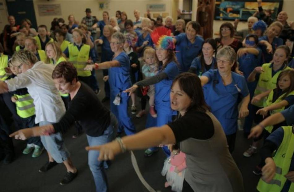 Dunstan Hospital staff, management, some patients and Clyde School pupils join in a flash mob at...