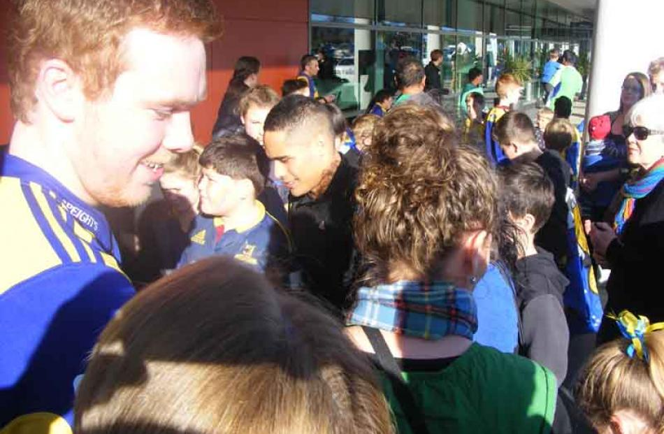 Aaron Smith is mobbed by fans.