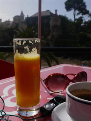 Freshly squeezed orange juice, a strong coffee, music and a view of the Cascais historic area...