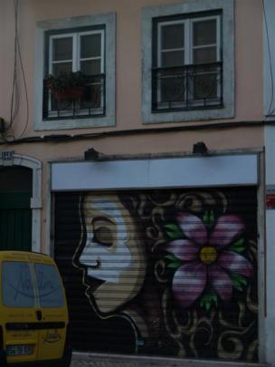 Lisbon's graffiti makes a colourful backdrop in a residential neighbourhood.