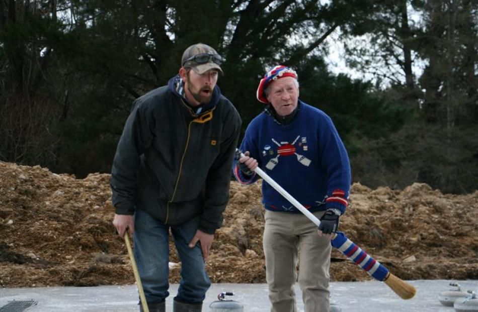 Dunstan Creek team member Chris Armstrong (left) and opposition Robbie Dobson, of Mt Ida, watch a...
