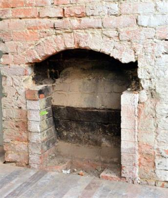 An old fireplace uncovered in the former corner bar.