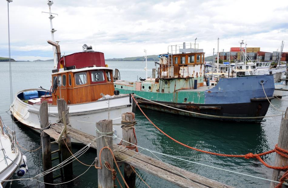 The Arataki (at right) tied up at Careys Bay in 2008.