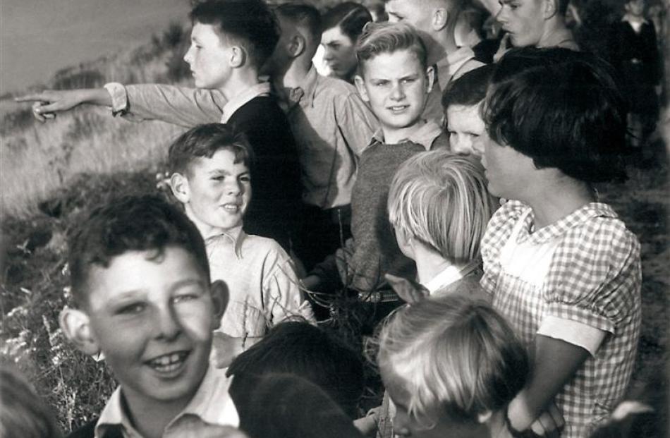Dunedin photographer Gary Blackman catches children at a gorse fire in  Northeast Valley in 1952....