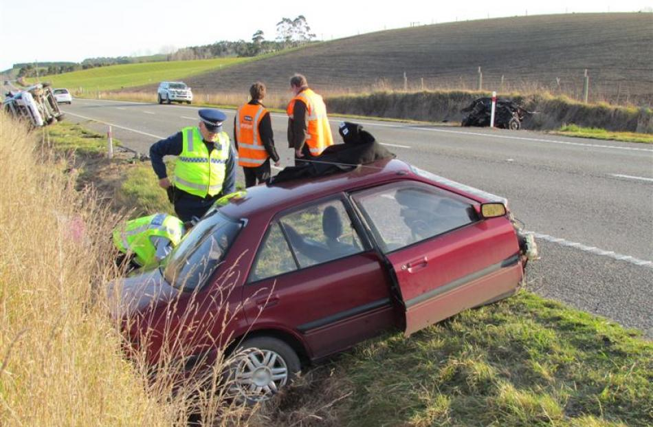 The main part of the  Mazda where it came to rest, across  State Highway 1 from the mangled front...