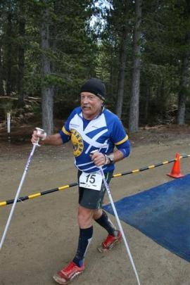Jim Kerse (67), of Dunedin, uses  poles in the 160km race.