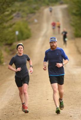 Sarah Morton, of Dunedin, runs beside Max Major, of Dunedin, during The Great Naseby footrace on...