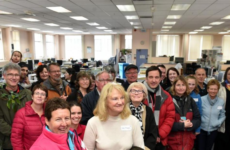 Festival participants take a tour of the editorial floor of the Otago Daily Times building on...