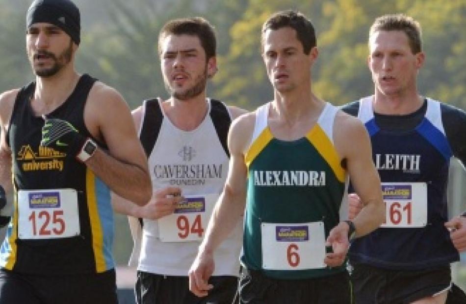 Dunedin marathon winner Romain Mirosa (left) leads (from second left) Jonah Smith, Glen Chisholm...