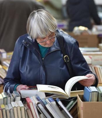 Hazel Ronald (84), of Mosgiel, takes a closer look at the book sale.