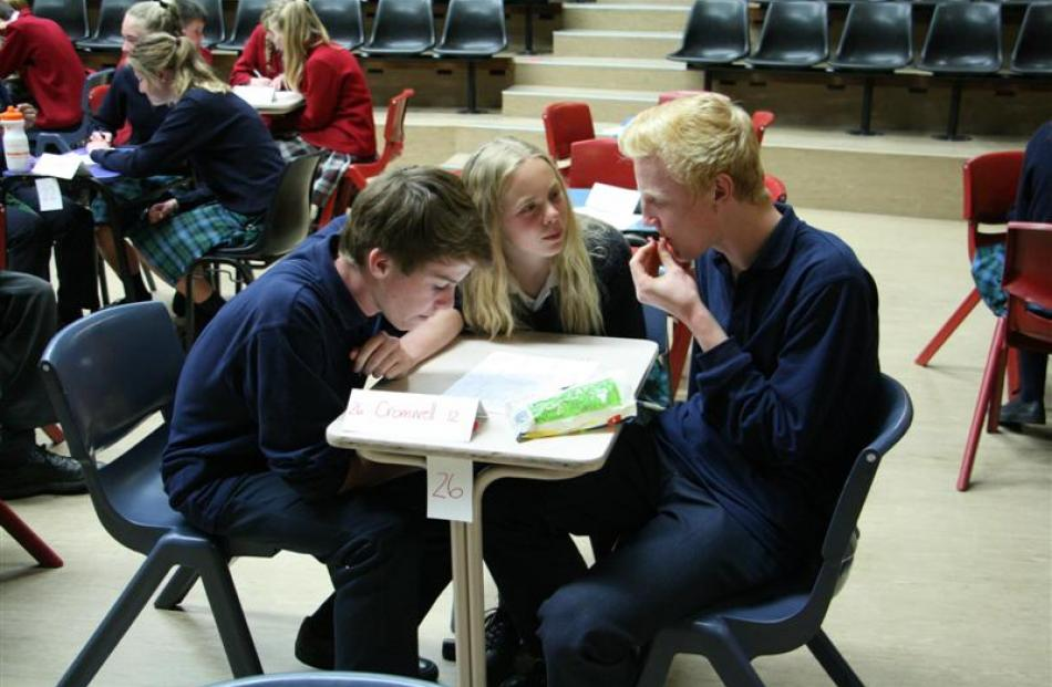 Team Cromwell 12 (from left) Sam Smith (14), Laurel Williams (15) and Bob Wardill (15) try to...