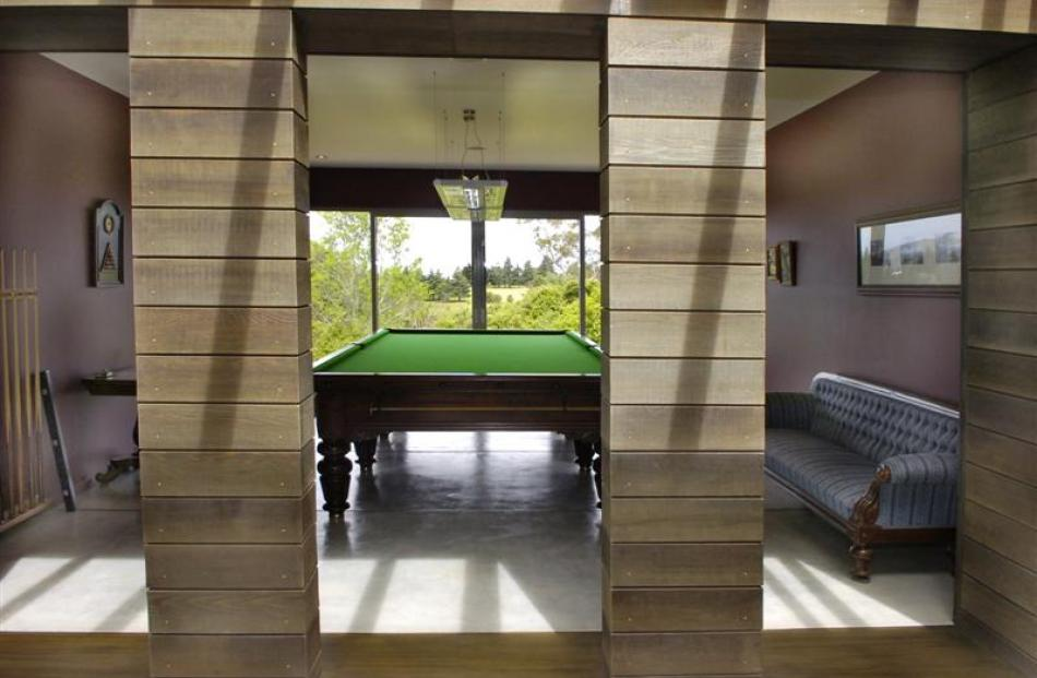 The billiards room is open to the corridor and overlooks the golf course. Photos by Jane Dawber.