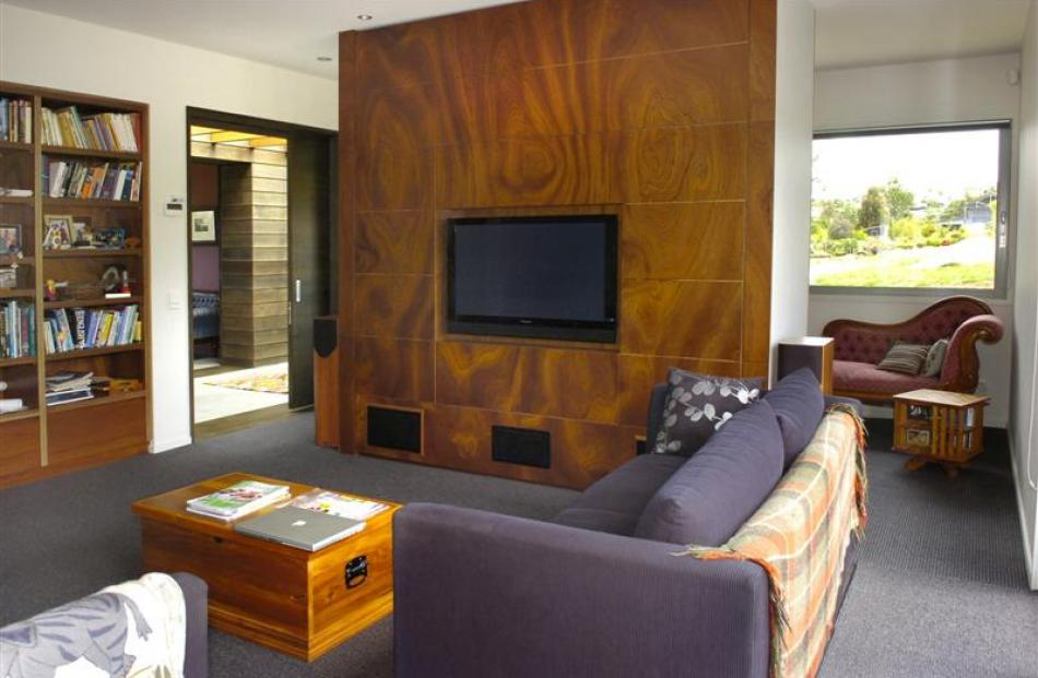 The cosy television room is divided from the office by a large storage unit housing the...