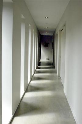 The recessed, cloister-like windows of the bedroom corridor capture the play of light and shade.