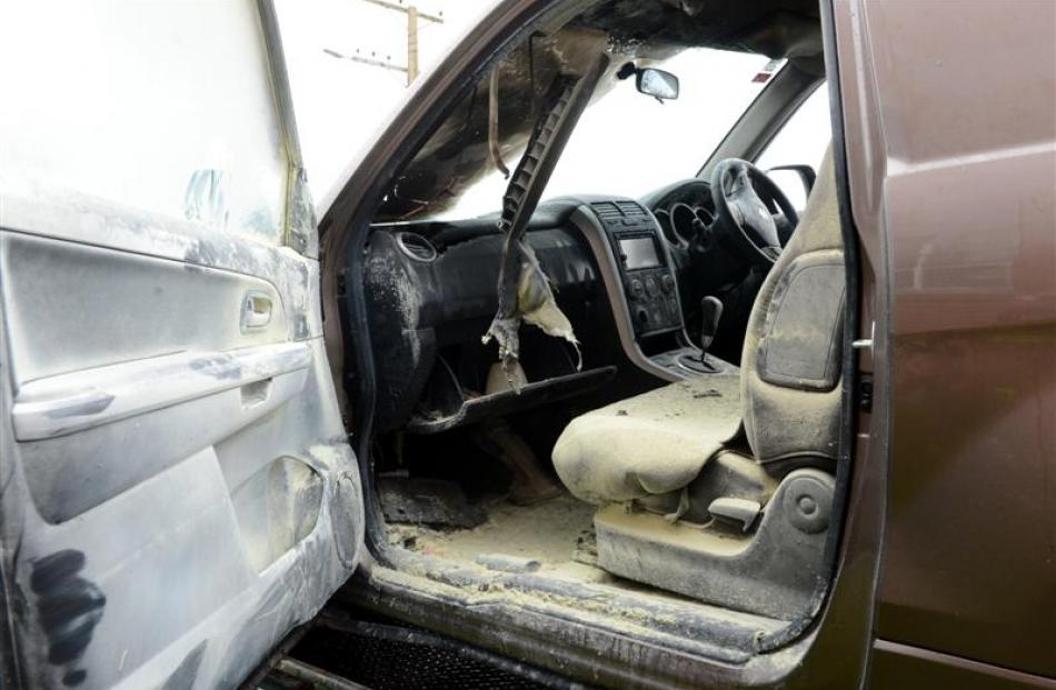 The fire-damaged interior of the vehicle.
