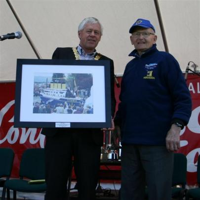 Central Mayor Tony Lepper presents Jan Belt with a framed photograph on Saturday. Photo by Liam...