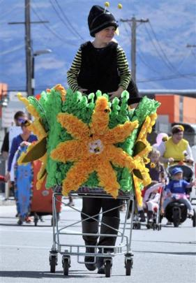 Dayla Turnbull (7), of Alexandra Primary School, on a spring flower ''florrey'' in the  parade....